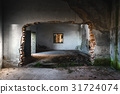 Damaged building interior with large hole 31724074