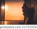 Hand silk tulle on window with morning sunlight 31725936