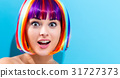 Beautiful woman in a colorful wig 31727373