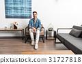 Joyful youthful guy having rest at home 31727818