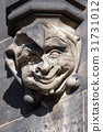 Stone head of the clown in Gothic style 31731012
