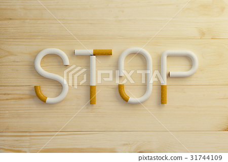 Text stop made of cigarettes on wooden background. 31744109