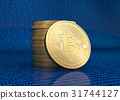 Stack of golden Bitcoins.  31744127
