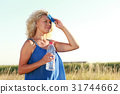 Mature woman with water bottle in summer 31744662