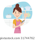 Young housewife kitchen phone 31744762