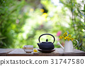 Black teapot and cup with flower at outdoor 31747580