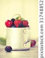 Berries in a rustic mug 31748852