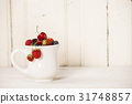 Mixed berries in a cup 31748857
