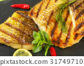 Grilled carp fillets 31749710