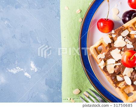 Sweet belgian waffles chocolate almond cherries 31750685