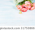 Beautiful pink ranunculus bouquet on turquoise 31750866