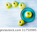 Green pastel background with apples. Healthy food 31750985