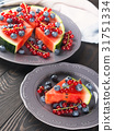 Slice of watermelon pizza cake with berries 31751334