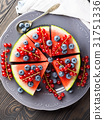 Slice of watermelon pizza cake with berries 31751336