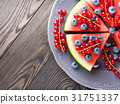 Slice of watermelon pizza cake with berries 31751337