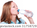 Young woman drinks mineral water isolated 31758729