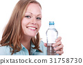 Young woman with bottle of mineral water 31758730