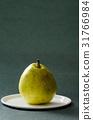 Pear fruit on white plate,still life 31766984