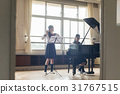 School girls practicing flutes 31767515