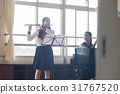 School girls practicing flutes 31767520