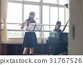 School girls practicing flutes 31767526