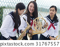 School girls who practice musical instruments on the rooftop 31767557