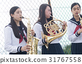 School girls who practice musical instruments on the rooftop 31767558