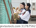 School girls who practice musical instruments on the rooftop 31767562