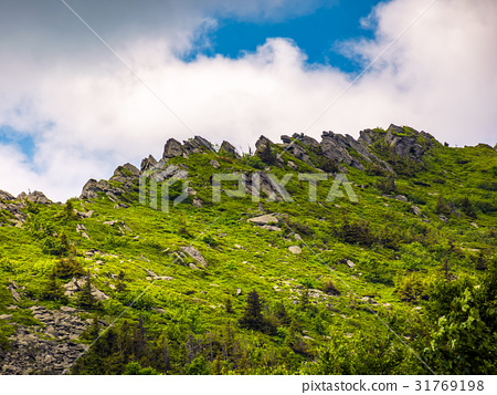 huge rocks on the edge of a mountain ridge 31769198