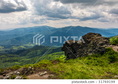 huge stone on the edge of a hill 31769199