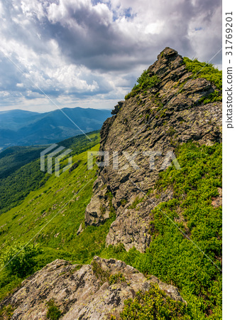 huge boulder on the edge of a hill 31769201