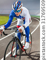 Racing cyclist on velodrome outdoor. 31769509
