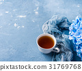 Cup of tea on blue background with flowers 31769768