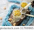 Chia oat pudding with quinoa, banana, pistachio 31769965