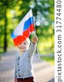 Cute little boy holding russian flag 31774480