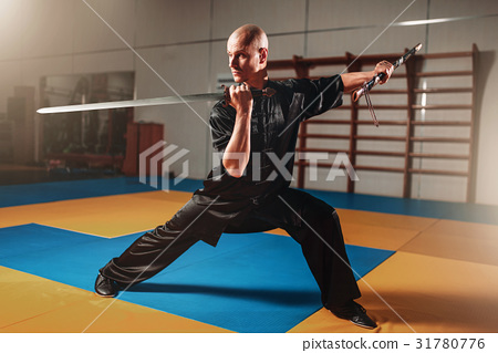 Wushu master training with sword, martial arts 31780776