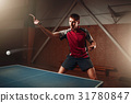 Table tennis, player in action, ball with trace 31780847