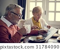Senior Adult Couple Eat Breakfast 31784090
