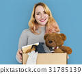 Woman Studio Portriat Casual Carrying a Box Isolated 31785139