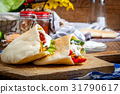 Fried chicken meat with vegetables in pita bread 31790617