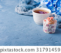 Cup of tea on blue background with flowers 31791459