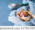 Vanilla ice cream scoops in waffle cup 31792100
