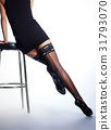 Beautiful legs of a woman in stockings 31793070