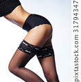 Beautiful legs in stockings on white 31794347