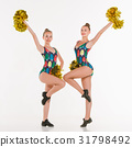 The two of teen cheerleaders posing at white 31798492