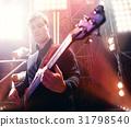 Bassist on stage. 31798540