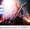 Bassist on stage. 31798541