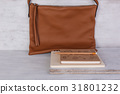 Still life brown leather bag and notebook 31801232