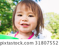 Happy toddler girl playing outside on a summer day 31807552