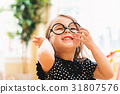 Happy toddler girl playing with glasses 31807576
